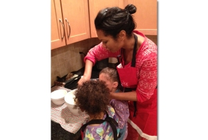 Harris cooking with her daughters, ages 6 and 3