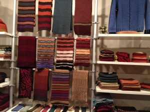 Shelves at Karen Allen hold hats, scarves, sweaters and other fine knits