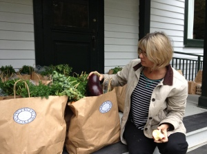 Carol Baxter readies bags of produce for pick up at Palisades Community Center