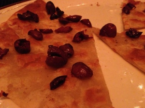 Here's that delicious gluten-free pizza with olives, olive oil and a scattering of flake salt