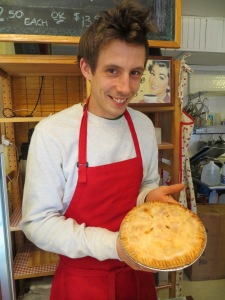 Co-owner Will proudly displaying a pie