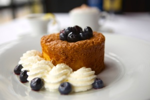 Warm butter cake with blueberry compote and fresh whipped cream