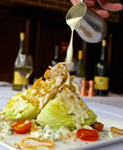 The Wedge Salad with tomato and crispy red onions.